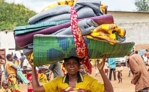 A Burundian mother flees into Rwanda to escape violence back home