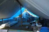 Displaced families used simple materials to build a temporary tent for themselves